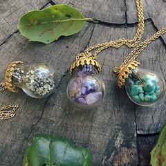 Potion trio in leaves closeup (lilyandquinn) Tags: necklace crystals bottles stones adventure jade amethyst pendant potion pyrite foolsgold properladysadventurekit potionpendant
