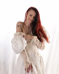 Showing a little ink... (Embodyment) Tags: female model modelmayhem dress studio kajira kajirabound striptease weddingdress
