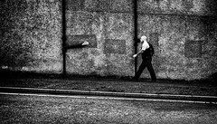 Taking the rough with the smooth. (Mister G.C.) Tags: blackandwhite bw image streetshot streetphotography photograph monochrome urban town city wall man male guy bald tattoos gritty grunge zonefocus zonefocusing snapfocus ricoh ricohgr pointshoot mistergc schwarzweiss strassenfotografie scotland britain greatbritain gb british uk unitedkingdom europe