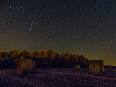 Shooting star (jonathankitt) Tags: trees summer longexposure sky night lights poselongue field nuit cantal auvergne stars ciel paille lumires champ straw arbres shootingstar botte ete etoiles ursamajor grandeourse lumixfz200 bundle ballot etoilefilante coren paysdesaintflour