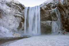 semi-frozen waterworlds (lunaryuna) Tags: iceland southiceland landscape waterfall skigafoss rockface icicles winter season seasonalwonders spray semifrozen visitors cold river ice le longexposure lunaryuna ngc