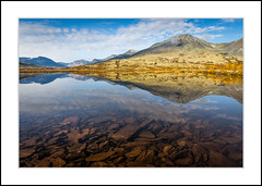 Rondane National park (andreassofus) Tags: landscape grandlandscape nature rondanenationalpark rondane drlseter fall autumn reflections mountains foreground rocks sky september norway