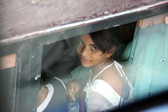 Faces of India - Young Girl In A Car (Culture Shlock) Tags: street travel people india smile portraits dehli younggirl