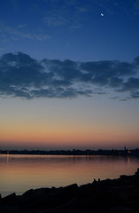 Moon, Sky and Water (hpaich) Tags: desktop morning wallpaper sky cloud reflection water dawn rocks skies nuvola background shoreline shore cielo nuvem nube desktopwallpaper wolk desktopbackground pilv
