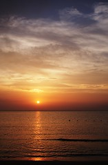 more sun is going down (SS) Tags: camera blue light sunset red sea summer vacation sky italy orange sun white seascape water colors beautiful weather yellow vertical backlight clouds composition contrast reflections skyscape photography gold golden evening