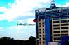 The Waving Flag (flickymikee) Tags: clouds composition buildings heaven philippineflag pilipinas 2012 nationalpride pinoypride wavingflag katipunanquezoncity