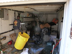 Clean out of flood damage garage in Ny after hurricane (The Trash it Man) Tags: hurricane cleanup howardbeach hurricanecleanup flooddamagecleanup hurricanesandy sandyaftermath
