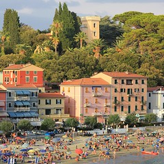 The beautiful Ligurian tower-houses of San Terenzo (Bn) Tags: pink blue trees houses girls sunset sea summer vacation sky italy panorama orange dog holiday seascape green castle beach water colors beauty yellow pine clouds swimming walking bay coast la oak sand ancient women san italia hiking turquoise magic liguria charm tourist panoramic medieval historic hills bikini vista colored lush viewpoint colori multi parasols lerici swimmng spezia ligurian liguri terenzo towerhouses panview golfdeipoeti