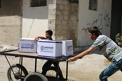 Delivering food aid to families in bombed-out Aleppo (Ummah Welfare Trust) Tags: syria levant war poverty hunger children middle east طفل الأطفال بلاد الشام حرب جوع فقر humanitarian humanitarianism islam muslims الإسلام مسلمون