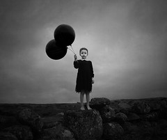 Imagine It (Maren Klemp) Tags: fineartphotography fineartphotographer darkart portrait kid child girl balloons nature outdoors darkness darkartphotography blackandwhite monochrome sky clouds dramatic fairytale nostalgic vintage evocative ethereal texture painterly dreamy