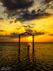 Swing in the water (natty_dobrescu) Tags: trawangan gili island indonesia golden hour goldenhour water sea seascape seaside balisea sunset sun waterscape scape asia photography travel exposure discover explore canon canon70d