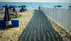 L'OMBRA LUNGA. (Skiappa.....v.i.p. (Volentieri In Pensione)) Tags: vacanze mare spiaggia ombra staccionata capalbio toscana panasonic lumix skiappa estate ombrelloni sdraio bagnanti vacanzieri sabbia
