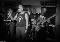 """No pasarn!"" (peterphotographic) Tags: 20160917225315sefexedwm iphone apple 6s silverefexpro2 blackandwhite bw monochrome walthamstow e17 eastlondon london england uk britain stevewhite stevewhiteandtheprotestfamily stowfest walthamstowmusicfestival warrantofficer livemusic live gig concert singer guitarist guitar mandolin pub publichouse festival agitprop punk folk music musician nopasarn"