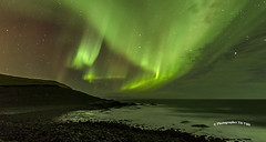 Northern lights ; Aurora borealis (Toi-Vido) Tags: light sea sky mountain reflection nature water beautiful rock landscape outdoors island lights iceland nikon aurora northern vestmannaeyjar sland sjr nttra northernlights borealis heimaey icelandic eyjar sk seawater fjara vido outofdoors landslag spegilmynd d7000 nikond7000 ti vd toivido tivd