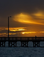 Sunset Contemplation (Tom Haymes) Tags: sunset orange silhouette clouds pier texas dusk palacios matagordabay palaciostexas matagordabaytexas