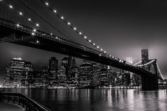 Brooklyn bridge and south Manhattan (Michel Couprie) Tags: city nyc bridge urban blackandwhite bw usa newyork reflection water skyline brooklyn night clouds canon river dark eos ramp eau mood cityscape noiretblanc nb 7d eastriver pont nuit reflets ville reflects fleuve buidings rampe 100commentgroup