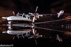 Mitsubishi Love (dkuttel) Tags: longexposure reflection rain japan night canon portland japanese flying ramp pdx mitsubishi fbo mu2 kpdx portlandinternationalairport canon7d