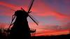 Sunset at the Fabyan Windmill (basicbill) Tags: light sunset cloud sun color colour weather clouds evening tramonto sonnenuntergang tpe puestadelsol thephotographersephemeris