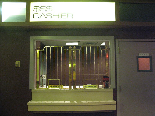 The cashier is offstage at the aged casino cage
