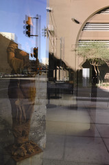 Sculpture and Reflections (GC_Dean) Tags: street city arizona sky urban color reflection window colors phoenix statue trafficlight morninglight cityscape colours shadows space structure vans crosswalk mundane emptiness appropriation sociallandscape boundfigure soupladle