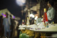 Eat - Drink - Fun Times (GoCiP) Tags: street carnival pakistan people food night fun photography 50mm nikon drink streetphotography photojournalism lahore mela d7000 nikond7000 gocip zeeshangondal