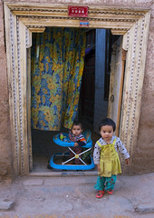 Kids in the Old Town Of Kashgar, Xinjiang Uyghur Autonomous Region, China (Eric Lafforgue) Tags: china street travel portrait people house tourism smiling vertical architecture outside person toddler day outdoor muslim curtain chinese shy uighur xinjiang silkroad littlegirl kashgar daytime uyghur minority kashi doorstep anthropology oneperson ethnicity onepeople sociology floraldesign peoplesrepublicofchina autonomy dayview turkic humanright uygur ouigour lookingatcamera colorpicture carveddoor 1people ethnicgroup learninghowtowalk chineseturkestan kachgar img8493 redsandal colourpicture xinjianguyghurautonomousregion qeşqer easternandcentralasia turkicethnicgroup countycitylevel