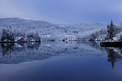 Mirror Blues (Richard Larssen) Tags: blue trees winter sea house snow reflection water norway forest landscape coast norge scenery sony norwegen richard scandinavia a77 sogn fjordane haugland larssen