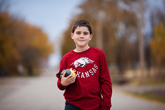 Turkey and Football (clay.wells (Explorer of the High Ozarks)) Tags: thanksgiving november light portrait canon lens photography eos prime kid dof natural bokeh outdoor mark clayton wells ii 5d usm ef 2012 135mm f2l img9344 thechallengefactory