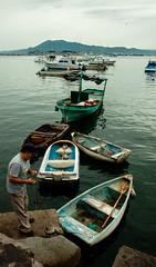 Pescador (E_co*) Tags: mexico mar embarcadero colima manzanillo pescador bote lanchas