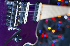 Guitar and Bokeh (MarkUK97) Tags: uk greatbritain blue red england music color colour colors yellow rock canon photography 350d 50mm lights maple europe colours dof purple unitedkingdom bokeh guitar britain mark angles peavey pickup depthoffield musical instrument canon350d gb strings eddievanhalen watts dslr f28 wolfgang vanhalen volume evh floydrose niftyfifty birdseyemaple humbuckerpickups markwatts