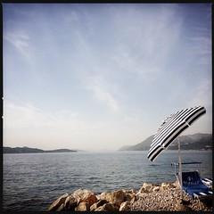 Wishful Thinking (peterphotographic) Tags: sea holiday beach apple umbrella square coast europe croatia parasol dubrovnik lounger 4s iphone dalmatia hotelpresident img0153 hipstamatic iphone4s
