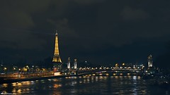 Paris La Nuit (Rick Nunn) Tags: city longexposure travel bridge paris tower water night clouds lights europe time rick eiffel nunn canonef50mmf14usm photospecs stockcategories