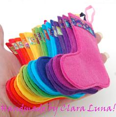 A Rainbow of mini felt Christmas stockings. (therainbowroom) Tags: rainbow handmade felt ribbon colourful therainbowroom farbenmix claraluna