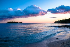 Sunset is the opening music of the night (The Green Album) Tags: rovinj croatia istria beach dusk blue hour pebbles seascapes clouds rolling lapping waves island meal colourful pink hues