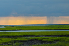 Rain over the Ocean (Gabriel FW Koch (fb.me/FWKochPhotography on FB)) Tags: landscape panorama sunset sunrise rainstorm rain storm downpour distant outdoor ocean inlet marsh beautiful awesome nikon p900 outside sky clouds red orange