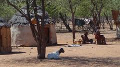 Huts, Women and Goat, Otjikandero Himba Village, Kunene, Namibia (dannymfoster) Tags: africa namibia otjikandero himbavillage otjikanderohimbavillage people africanpeople himba woman himbawoman hut goat