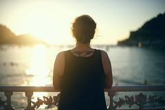 Looking over the Bay (NoelleBuske) Tags: summer ocean nikon tattoo sun bokeh light sea sunset sunlight sansebastin spain espaa hair back travel lifestyle girl golden goldenlight vacation