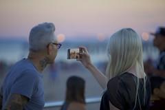 Woman Selfie (Litratistica Images NYC) Tags: beach camera candid canon70200mm canoneos5dmk2 coneyisland man nightshoot nightshot outdoor people selfie smartphone sunset womanselfie women wonderwheel