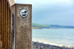 Round Wales Walk 40 - Ceredigion Path Sign (Nikki & Tom) Tags: walescoastpath wales ceredigion uk beach pebbles sign bay coast sea