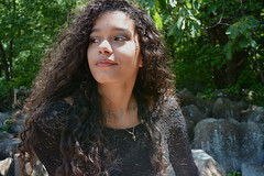 'Athena' (miranda.valenti12) Tags: athena smiling posing portrait looking away sitting nature outdoors outside forest woods hiking hike outdoorsy rocks hair curly sunlight light tree trees branches leaf leaves branch landscape