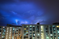 Lightning Storm #2 (BoXed_FisH) Tags: architecture housing lightning singapore sony sonya7 sonyalpha wideangle storm blue bluesky samyang14mm samyang flats rain