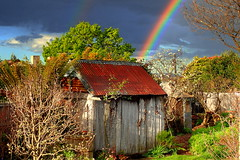 There's a RAINBOW over my GARDEN (elliott.lani) Tags: garden rainbow rainbows shed shearingshed applepickershut hut old relic historic historicshed weatherboards rustic homegarden sky clouds wow