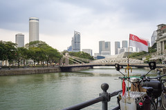 Flag Waving by Singapore River (danliecheng) Tags: asia fullertonhotel marinabay rafflescity rafflesplace singapore singaporeriver sunteccity attractions bicycle bridge buildings cavenage financialcenter flags place railing river travel trees visit water waterfront waving