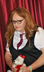 Kay goes back to school! (Kay Bea Chisholm) Tags: redblack tie grinning spectacles teddy white black dress pinafore blouse redhead nerdy sexy schoolgirl kay