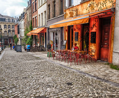 Cafe in Brussels, Belgium (` Toshio ') Tags: toshio brussels belgium bruxelles belgian cafe restaurant chairs table street city cityscape people cobblestone fujixe2 xe2