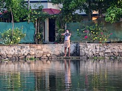 Starting the Day (The Spirit of the World) Tags: man local bathing soap lake water morning lather suds backwaters kerala india southernindia flowers