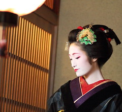 The maiko (geisha apprentice) Kofuku /   / Kyoto, Japan (momoyama) Tags: city travel blue winter light red portrait people woman colour girl beautiful beauty face fashion japan night canon hair outdoors photography japanese costume clothing kyoto asia day traditional ceremony culture makeup 85mm maiko geiko geisha 7d   cosmetics kanzashi