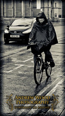 Drowned Rat Day (Andrew Wood Photo) Tags: blackandwhite bw rain manchester rat cyclist oxfordroad professionalphotographer downpour drowned raincape andrewwoodphotography
