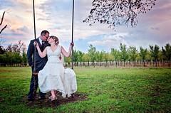 Bride & Groom In Vineyard (Thomas Hibben) Tags: wedding sky oklahoma groom bride vineyard couple married dress orchard swing
