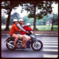 Three on a scooter in Hanoi (Lil [Kristen Elsby]) Tags: road street lake topf25 square streetphotography scooter vietnam motorbike squareformat motorcycle editorial hudson hanoi panning topv4444 reportage hoankiem iphone hoankiemlake iphoneography threeonabike instagram instagramapp